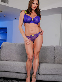 Foxy big tit MILF Kendra Lust gets rid of her lingerie and poses butt naked