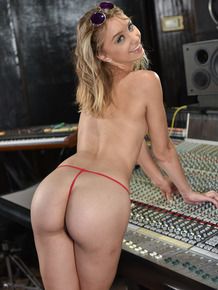 Naughty brunette Aurora Belle is feeling hot and horny at the music studio
