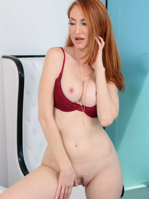 MILF redhead Kendra James dons strap-on to fuck hot blonde Raylin Ann
