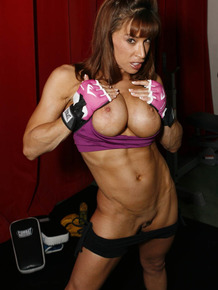 Busty muscled boxing babe Devon Michaels gets naked for hot gym posing
