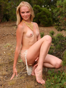 Skinny blonde hottie Valya comes on the hill for a nude photo session with