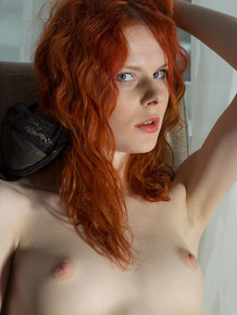 Pale redhead from Latvia masturbates after teasing her nipples