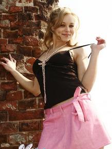 Blonde amateur Ira exposes her panties and ass in a pink miniskirt