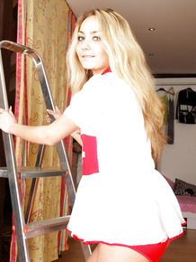 Stunning babe in nurse uniform Victoria I stripping and toying her muff
