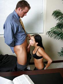 Pretty brunette Stephanie is blowjob giving schoolgirl in the office