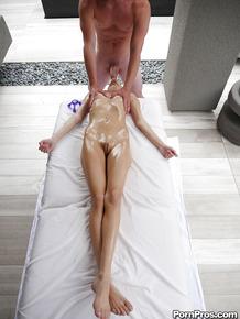Teen pornstar Rebel Lynn giving her masseur's big dick oral sex