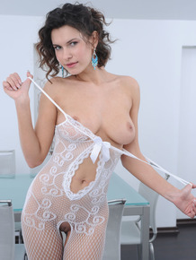 Erotic babe Suzanna A in pantyhose undressing to spread legs wide open