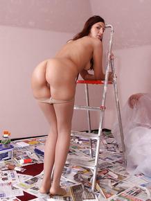 European teen babe Meg Magic rolling down pantyhose to spread pussy