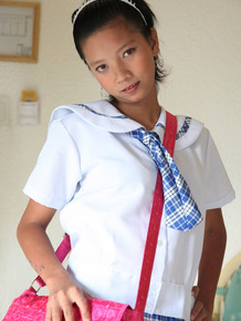 Adorable Asian schoolgirl Sally slides her cute panties aside to show her twat