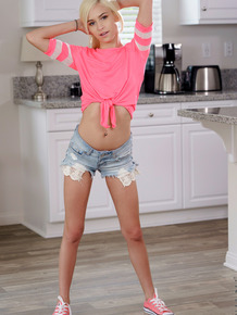 Blond teen Kiara Cole uncovers her pierced nipples before spreading labia lips