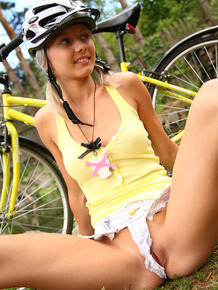 Young blonde girl Pinky June finger fucks after a bike ride