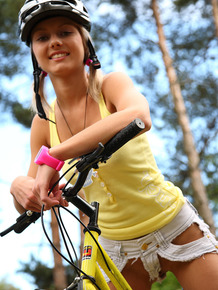 Young blonde girl Pinky June masturbates in yard after a bike ride
