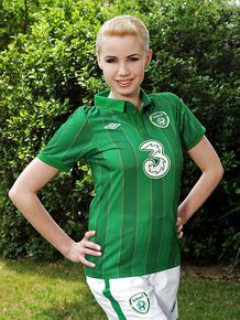 Seductive blonde Shannon Reid slipping off her football uniform outdoor