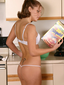 Teen amateur fixes herself breakfast in a white bra and thong combo