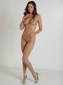 Spanish redhead Jayden Cole squeezing her natural tits and strips down naked