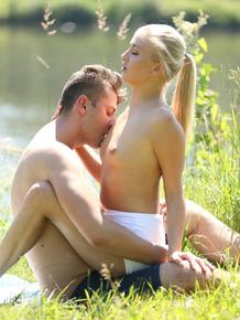 Cute blonde Cayla Lyons fucks her boyfriend next to a peaceful river