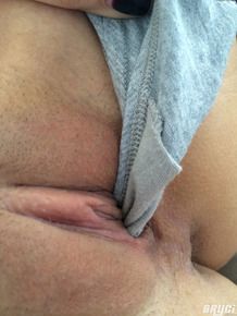 Amateur female Bryci taking selfies while pulling panties out of cunt crack