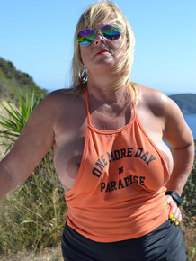 Slutty mature nudist with large tits Chrissy shows her hot curves at the beach