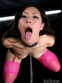 Collared Japanese girl endures hardcore mouth fucking in pink stockings