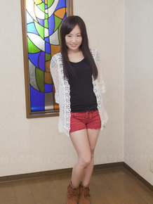 Innocent Japanese babe poses in her cute red short at the casting