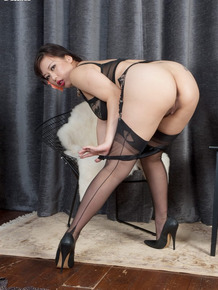 Asian MILF Tigerr Benson strips to backseam nylons and heels