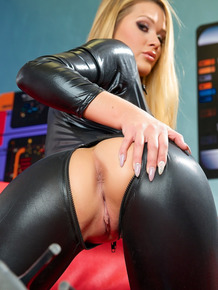 Hot blonde chick Abby Cross shows her stuff in a crotchless leather catsuit