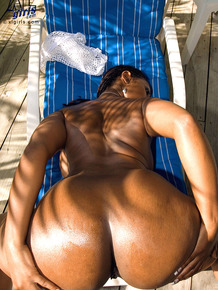 Hot ebony fatty in sheer lingerie flaunts oiled big booty in the tropical sun