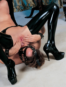 Blonde female and masked man friends have hardcore sex in latex clothing
