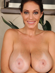 Big titted MILF Charlee Chase flashes her huge knockers & spreads muff outside