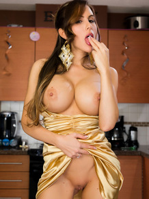 Elegant Katie Banks entertains herself in the kitchen with party favor inserts