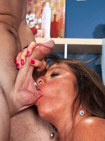 Freckled cougar takes her toy boy's ball sac in her mouth during sex