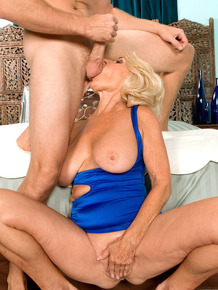 Mature woman Georgette Parks takes a cumshot on nice tits from younger lover