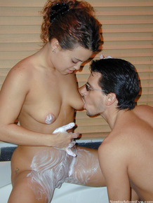 Horny couple Eve and Adam shave each others private parts in a hot tub
