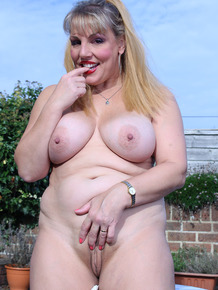 Large BBW Danielle T stripping in the yard to sun mature big tits & fat ass