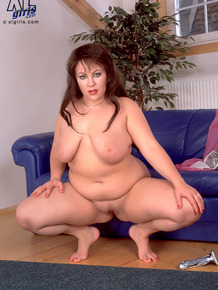 Fatty MILF Anastasia massing her silver dildo with her large knockers