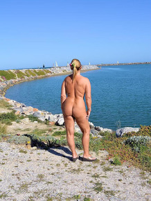 Naughty mature nudist Chrissy likes showing off her hot huge tits on the beach