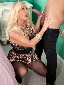 Hot older Barbi Banks gets on knees for blowjob & big boob melon titjob