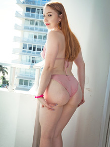 Natural redhead Arietta Lex plays with her trimmed pussy after removing bikini