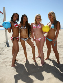 Four naked lesbians break out the sex toys after a game of beach volleyball