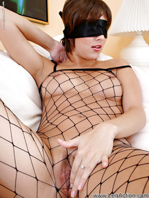 Fuckable babe in fishnet pantyhose suit fingering her wet pussy
