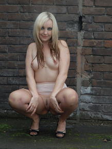 Solo model Jess Wood flashes in a back alley in retro underwear and nylons