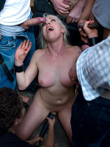 Blonde female Lorelei Lee is restrained and caned during a gangbang