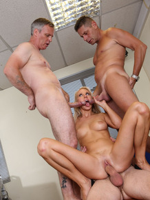 Blonde secretary Carla Cox partakes in a gangbang over her lunch hour