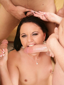 Dark haired first timer sucks off three cocks at the same time