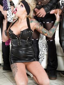 Blonde groupie Burning Angel sucks cock for cum in gangbang scene