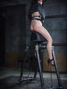 White girl Nikki Nightly licks the floor during extreme bondage session