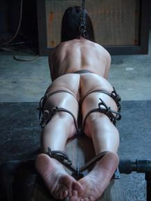 Dark haired slave India Summer undergoes brutal BDSM in various restraints