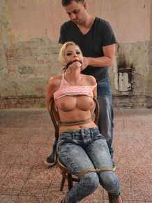 Jeans clad Karol gets herself bound to a chair and gagged in BDSM tit groping