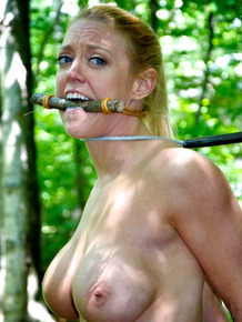 Two females find themselves restrained with ropes and fucked in the woods