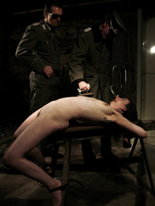 Naked and restrained female is tortured and penetrated by her captives